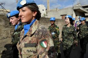 women in millitary garb and UN peacekeeper berrets patrol streets in lebanon