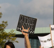 Protestors calling for climate justice. Which will will Canada go?